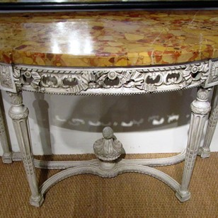 A painted demi lune console