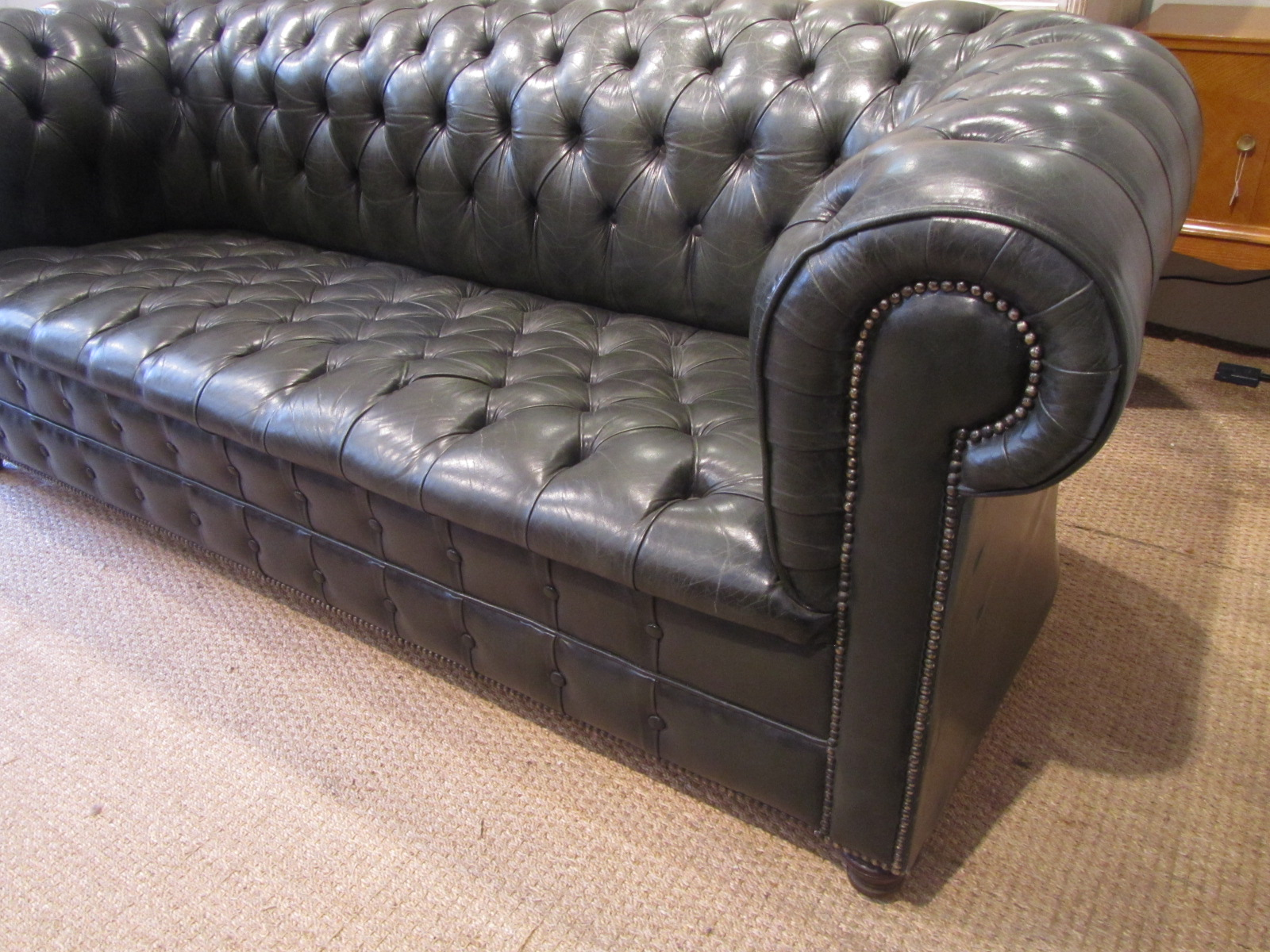 A Fully Buttoned Leather Chesterfield Sofa Decorative Collective