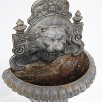 Cast iron lions head fountain
