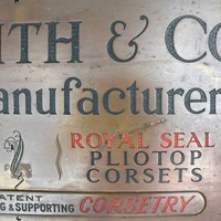 engraved  brass Corset shop sign