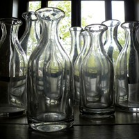 Collection of 9 french cider carafes