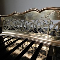 A fine George III serpentine fireplace fender