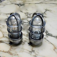pair of polished aluminium bulk head lights