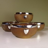 Set of four silver mounted oak bowls