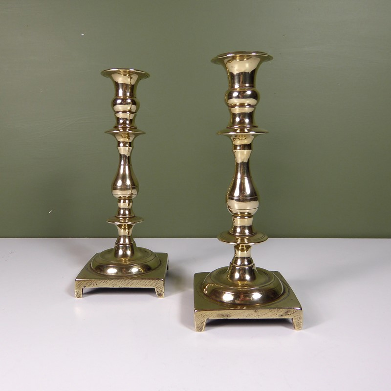 Pair of cast brass candlesticks-mytton-antiques-brass-main-637355087475870565.JPG