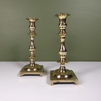 Pair of cast brass candlesticks