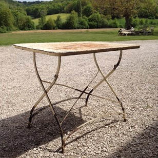 Stylish wrought iron and tole garden table