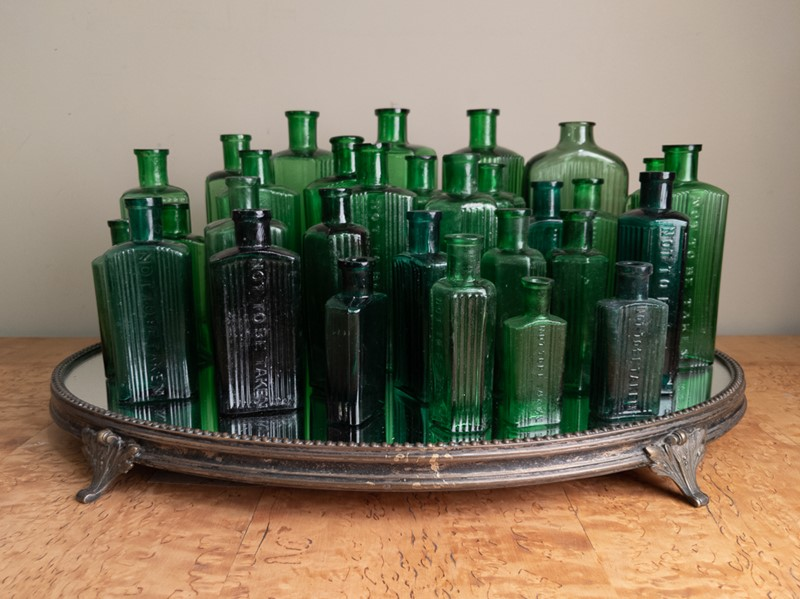 A collection of 30 Green Glass Poison Bottles -nick-jones-img-20200705-104054-main-637303322161612661.jpg