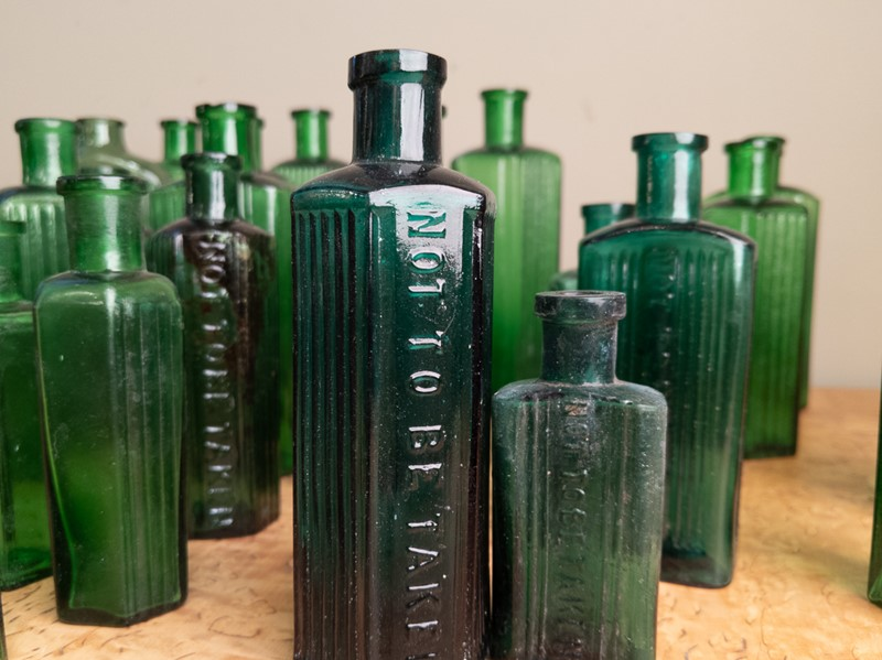 A collection of 30 Green Glass Poison Bottles -nick-jones-img-20200705-104428-main-637303322618484953.jpg