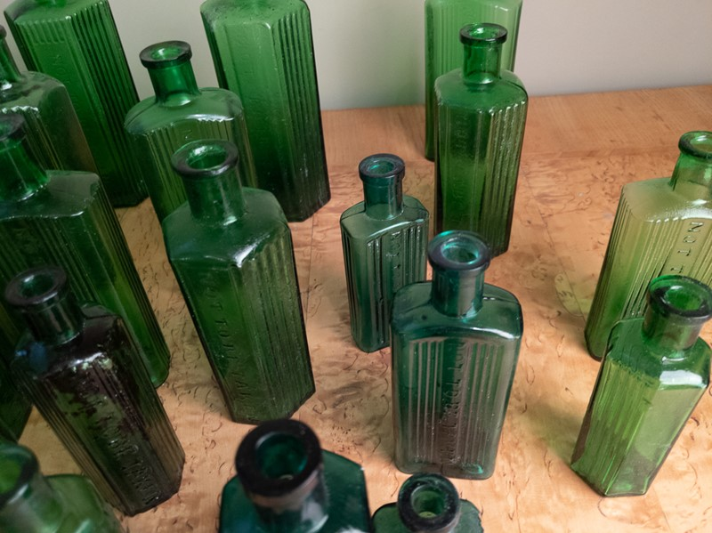 A collection of 30 Green Glass Poison Bottles -nick-jones-img-20200705-104452-main-637303321241617996.jpg