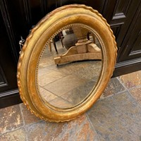 C1880 A Small Oval Gilt Mirror
