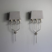 Two smart pairs of silver plate wall sconces