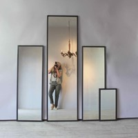 Reeded set of early ebonized slim framed mirrors