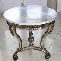 Round table with silverleafed base