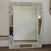 White painted mirror with vine corners