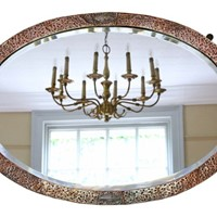 Oval Art Nouveau copper and brass wall mirror