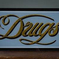 Hand Painted 18ct. Gold Leaf Glass Drugs Sign