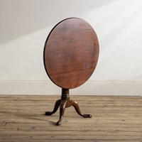 A George II mahogany 'bird-cage' tripod table