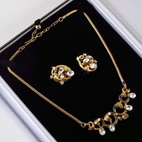 Trifari rhinestones on gold tone necklace & earrings