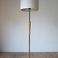 A 1960s French brass and wood floor lamp