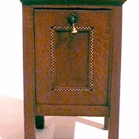An inlaid oak Arts & Crafts coal box