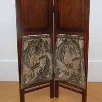 An oak firescreen with carved panels