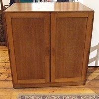 A Heals double-sided cupboard