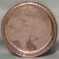 A copper tray  by Hugh Wallis