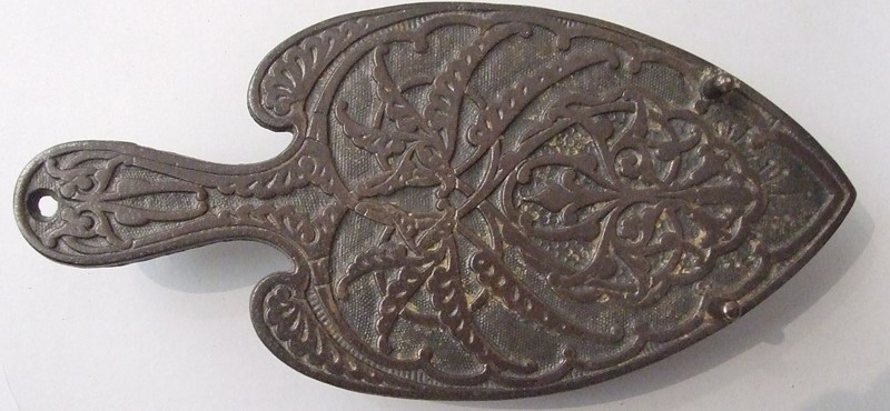 A cast iron trivet by Christopher Dresser-the-millinery-works-s3758-main-637254992012027971.JPG