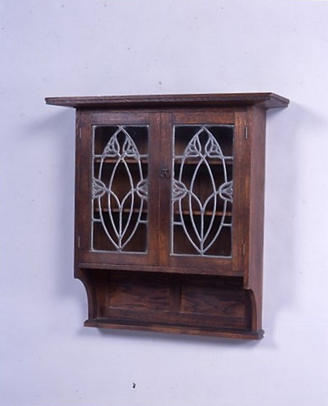A glazed, oak wall cabinet circa 1900-the-millinery-works-s4285-main-636898176708897932.jpg