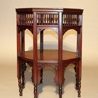 A mahogany two-tier Moorish table attr Liberty