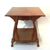 A walnut two-tier centre table attrib Eastlake