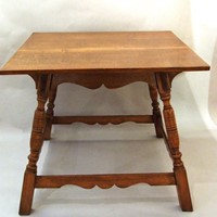 An oak centre table after Charles Eastlake