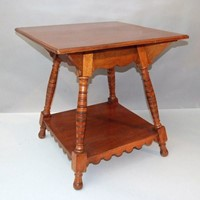 A walnut two-tier centre table