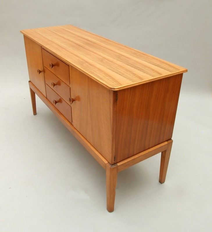 A walnut sideboard  Russell's of Broadway-the-millinery-works-s5835-2-main-636890529820300592.JPG