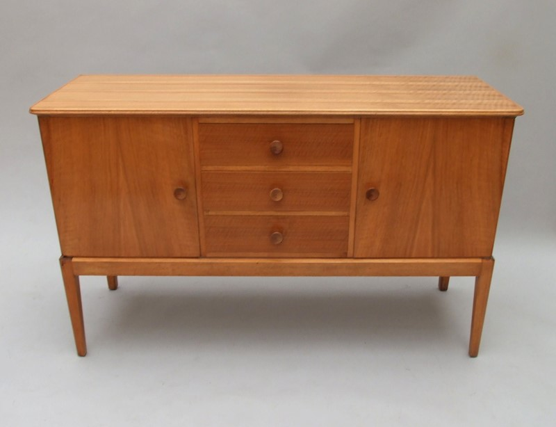 A walnut sideboard  Russell's of Broadway-the-millinery-works-s5835-main-636890529735457864.JPG