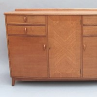 An oak Russell of Broadway sideboard