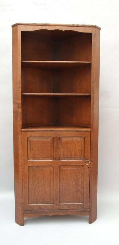 An oak Cotswold style corner cupboard-the-millinery-works-s6423-1-main-637052939127308980.JPG