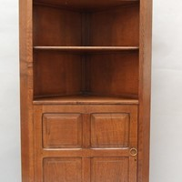 An oak Cotswold style corner cupboard