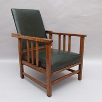 An Arts & Crafts oak reclining armchair