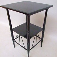 A Godwin design ebonised two-tier coffee table