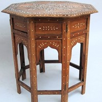 A beautiful inlaid hardwood octagonal table