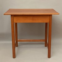 A Gordon Russell cherrywood and mahogany table