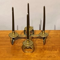 A fine set of four VoyseArts & Crafts candlesticks