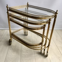 Beautiful nest of vintage brass tables/trolleys