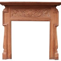 An Antique Art Nouveau Oak Fireplace Surround
