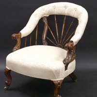 A Howard and Sons rosewood arm chair