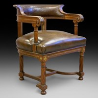 A rare bold 19th century brass inlaid arm chair