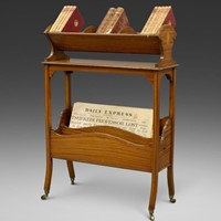 An Edwardian satinwood book trough