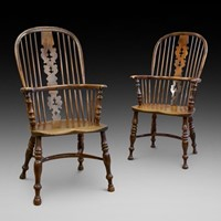 A matched pair of yew wood arm chairs
